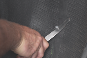 8. using a flexible knife, cut the plug on the inside of the tire 1/8-inch above the innerliner. be careful not to stretch the plug when cutting.