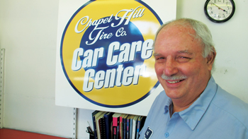Raymond Mann, lead service tech and resident BMQ expert, is one of dozens of long-time employees. He is closing out his 30-plus year career with Chapel Hill Tire this year.