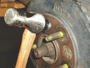 Rapping the brake drum between the lug bolts with a two-pound or larger hammer will generally loosen the drum. In some applications, the brake drum incorporates two threaded puller screw holes designed to expedite drum removal.