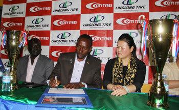 Fuba President Ambrose Tashobya signs a partnership aggreement with Shandong Linglong Tyre Co.