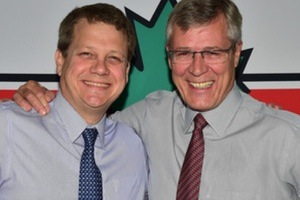 Stephen Wetmore congratulates Michael Medline on his appointment to President and CEO of Canadian Tire Corp.