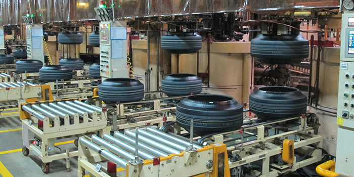 Green tires await their turn in curing presses at Nexen's Changnyeong plant.