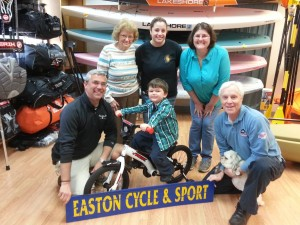Raffle winner James Willey with family, Ryan Hickey of Easton Cycle & Sport and Mid-Atlantic TirePros owner Terry John.