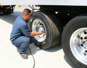 Bear-Trucking,-putting-air-in-Yokohama-tire