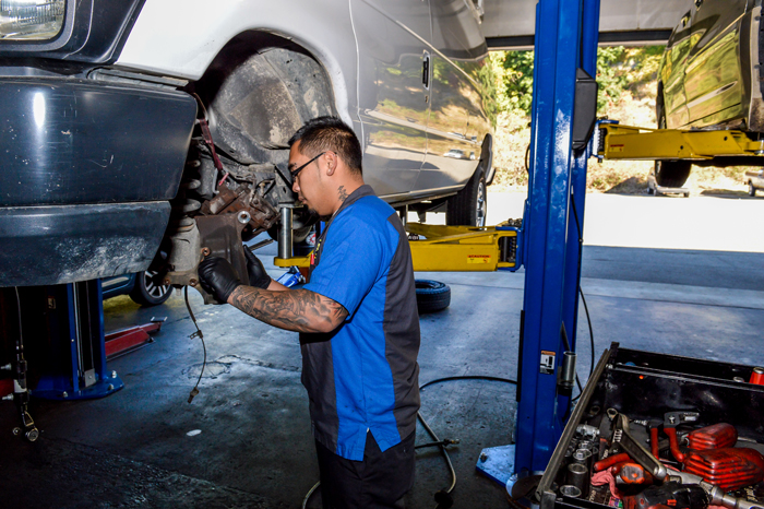 Technicians record vehicle and tire service information on a tablet to share with customers. (Josh Fernandez      Photography)
