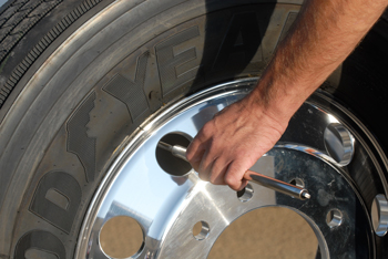 Checking tire pressure on a regular basis is vital to tire life and avoiding a CSA violation for an underinflated or flat tire.  (Goodyear photo)