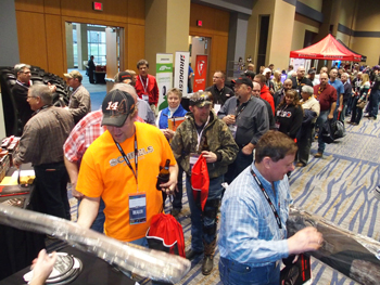 By far, the hot item at the K&M Tire Dealer Conference trade fair were Cabella's gun sleeves, given away by Bridgestone Americas. The tiremaker faced long lines as it gave away hundreds of the cases.