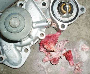 """A leaking water pump concealed under a timing cover can create a coolant """"icicle"""" that might fall into the crankshaft timing belt sprocket."""