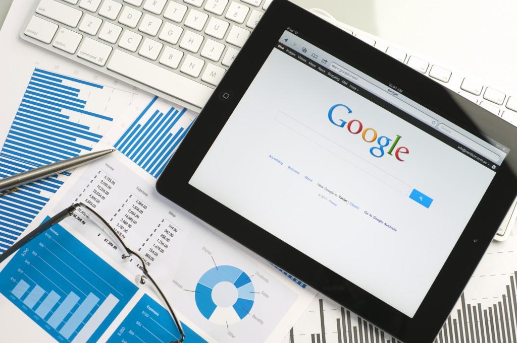Ipad on a desk showing google