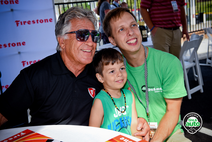 Mario Andretti poses with Dale Gilbert, Virginia Tire & Auto employee and his son at the Bristow facility. Photo by Jim Folliard/Gearshift.TV