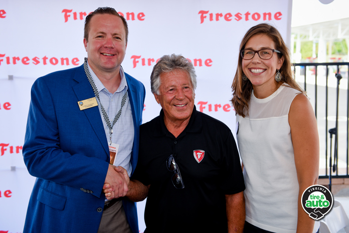 Corey Stewart, chairman of the Prince William County, Va., Board of Supervisors, and  Julie Holmes, president of Virginia Tire & Auto, pose with Mario Andretti. Photo by Jim Folliard/Gearshift.TV