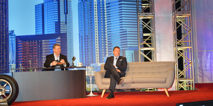 Bridgestone's John Baratta plays talk show host, shown here with special guest Gordon Knapp, at the Bridgestone Consumer Tire Business Meeting in Los Angeles in November.