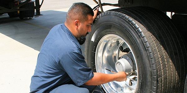 Bear Trucking, putting air in Yokohama tire