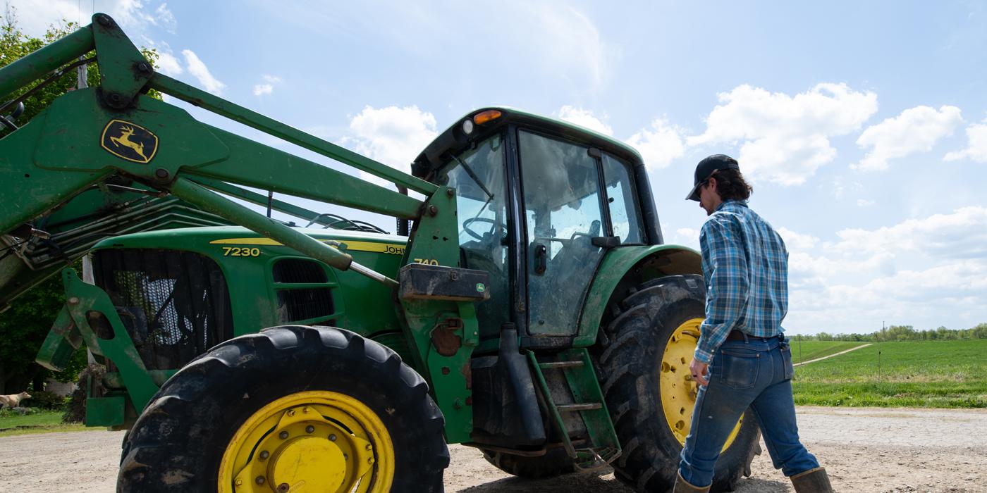 Jarad-Sage-walking-to-tractor-Ag-Dealers