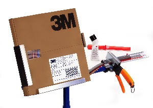 3M's wheel weight system, which includes a roll of weights, a stand and a cutting device designed to measure the weight needed to the nearest gram.