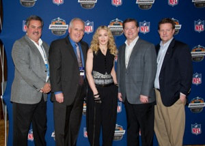 Super Bowl Halftime Show performer Madonna with (from left) Bridgestone's Phil Pasci, vice president of consumer marketing; Larry Magee, president of consumer tire; John Baratta, vice president of consumer tire; and Philip Dobbs, chief marketing officer.