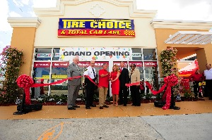 at the new flagship store's ribbon cutting last november were (from left to right): michael galvin, vice president of communications for the better business bureau; al lamberti, broward county sheriff; mario andretti; diane and dan hennelly; and allegra webb murphy, oakland park mayor.