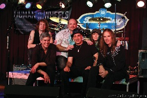 The John Mellencamp tribute band Human Wheel features Joel Caplan, owner/partner of Piscataway, N.J.-based BC Tire, on bass guitar (center with hat).