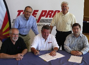 howard fleischmann (center), president of community tire in phoenix, signed on as a tire pros franchisee. with him are (seated l to r) kim sigman, community tire; and kirk papazian, tire pros director. standing are jerry knapp, tire pros regional vice president; and carey mellor, tire pros vice president.