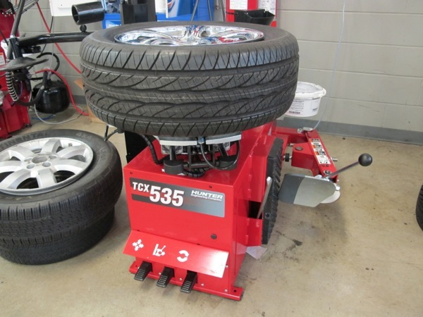 5: secure assembly on tire changer. in this photo, the assembly is on a tabletop or rim clamp style changer.