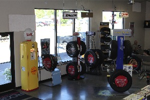 Neat and clean tire displays and motoring treasures decorate the large showroom.