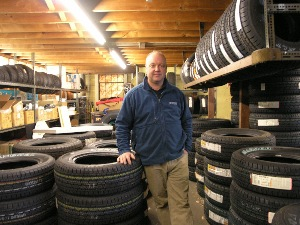 by the time he finally landed in the u.s., spencer carruthers was already a well-seasoned immigrant. now, with his successful kenwood tire co. in massachusetts, he's a noted tire dealer.