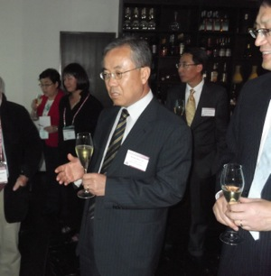 Byung-Woo Lee, Nexen executive vice president of sales, toasts the companys success at Mays media event.