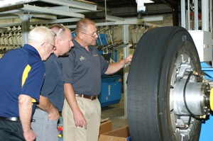 Ed King (right) shows fleet attendees an up-close view of the new ContiLifeCycle retread system at Kings Tire Service.