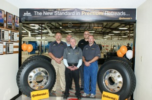 From left: Ed King; Paul Williams, Continental's executive vice president for truck tires; Sam King; Clif Armstrong, director of marketing for CTA; and Matt King.