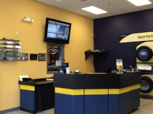 service advisor space is sharp and neat, minus the confusing clutter. instead, the video message and price board allow customers to see tire and service options.