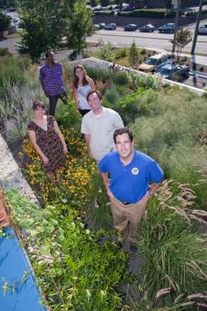 the rooftop garden takes more than a little tending, so chapel hill tire relies on local help to keep the woodcroft store green and growing  on top.