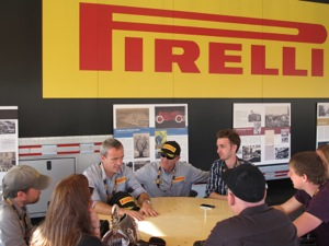 Paolo Ferrari, chairman and CEO of Pirelli Tire North America (left), and Tom Gravalos, vice president of marketing and OE, speak with media at the launch event.