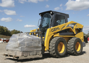 many skid-steer loaders, like the gehl v330 above, now use foam-filled, semi-pneumatic or solid tires to reduce the chance of getting flats.