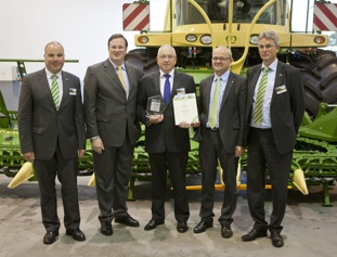 From left: Uwe Hansult, managing director of Krone; Bernard Krone, general director and owner Krone; Gerhard Schulterobben, Mitas German sales subsidiary director; Georg Sasse, purchasing manager for Krone; and Wolfgang Bellon, quality manager for Krone.