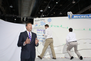 Mitch Butler of The Fast Draw illustrated the benefits of the new tire on a white board while Scott Clark spoke.