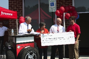 Myron Boncarosky, Virginia Tire & Auto owner, presented the Spirit of Liberty Foundation with a $1,000 donation check in honor of Sgt. Sean Callahan. Sgt. Callahan's mother, Jan Callahan, attended the commemorative ceremony, along with local officials Delegate Dick Black and Scott York, chairman of the Loudoun County Board of Supervisors.