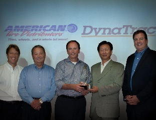 Recognizing the sales milestone were (from left) Dave Dyckman, ATD executive vice president; Phil Marrett, ATD executive vice president; Bill Berry, ATD president and CEO; Mike Yang, CMA president; and Aaron Murphy, CMA vice president.