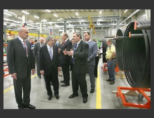 Iowa Gov. Terry Branstad (front center) gets a tour of the new Mitas tire plant in Charles City, Iowa. With him is Mitas Tires North America President and Plant Director Pavel Charvat; Tomas Nemec, chairman of Mitas' parent company CGS; and Petr Gandalovic, ambassador of the Czech Republic to the U.S.  Photo by Jeff Heinz, Globe Gazette.