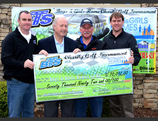Gary Faircloth, president and CEO of Boys and Girls Homes of North Carolina (second left) is presented a check by Black's Tire Service owner Ricky Benton (third from left), for the amount raised at the 2012 BTS Charity Golf Tournament held April 13. Assisting with the presentation are Benton's sons Rick II (left) and Ryan (right).